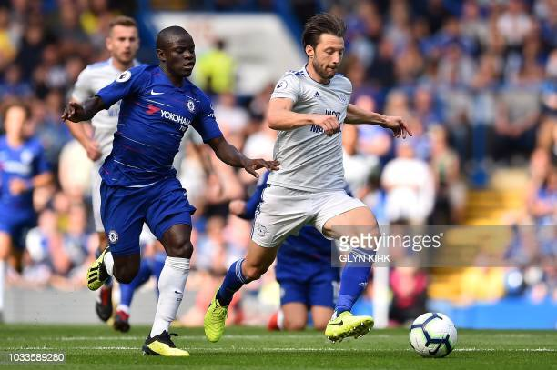 Chelsea's French midfielder N'Golo Kante vies with Cardiff City's Englishborn Irish midfielder Harry Arter during the English Premier League football...