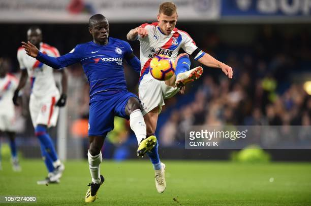 Chelsea's French midfielder N'Golo Kante vies with Crystal Palace's German midfielder Max Meyer during the English Premier League football match...