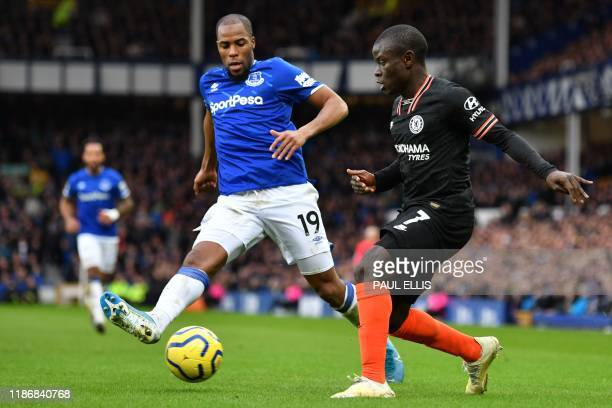 Chelsea's French midfielder N'Golo Kante vies with Everton's French Defender Djibril Sidibe during the English Premier League football match between...
