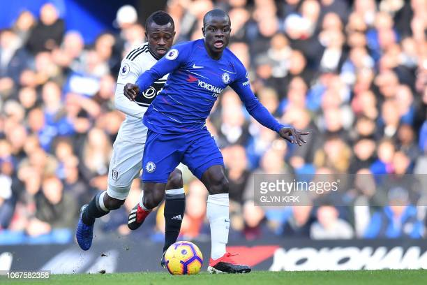 Chelsea's French midfielder N'Golo Kante vies with Fulham's Ivorian midfielder Jean Michael Seri during the English Premier League football match...