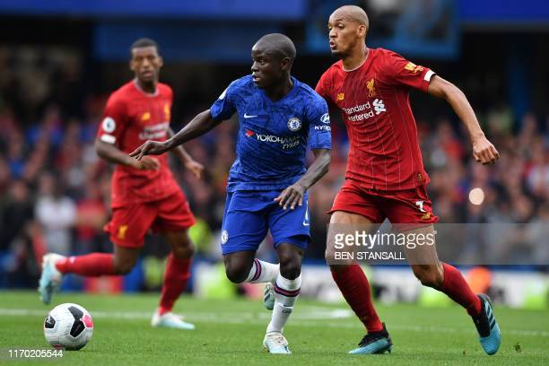 Chelsea's French midfielder N'Golo Kante vies with Liverpool's Brazilian midfielder Fabinho during the English Premier League football match between...