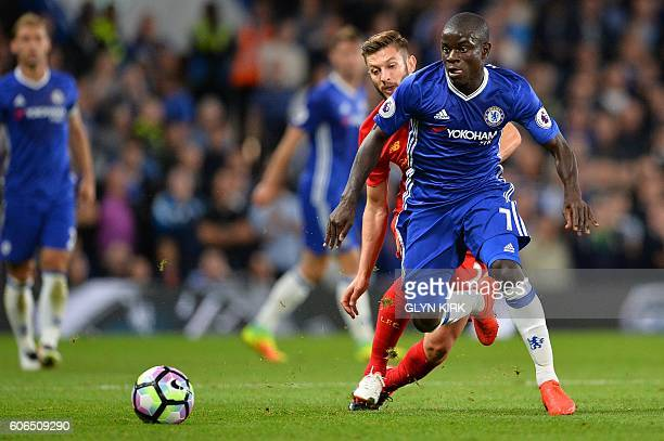 Chelsea's French midfielder N'Golo Kante vies with Liverpool's English midfielder Adam Lallana during the English Premier League football match...