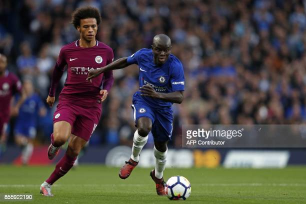 Chelsea's French midfielder N'Golo Kante vies with Manchester City's German midfielder Leroy Sane during the English Premier League football match...