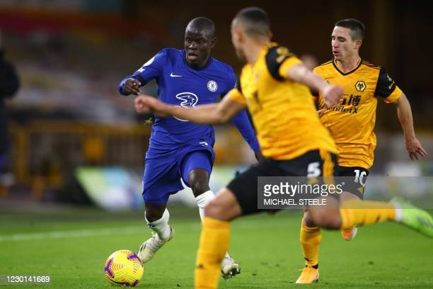 Chelsea's French midfielder N'Golo Kante vies with Wolverhampton Wanderers' Brazilian defender Marcal and Wolverhampton Wanderers' Portuguese...