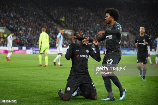 Chelsea's French midfielder Tiemoue Bakayoko celebrates after scoring with Chelsea's Brazilian midfielder Willian during the English Premier League...