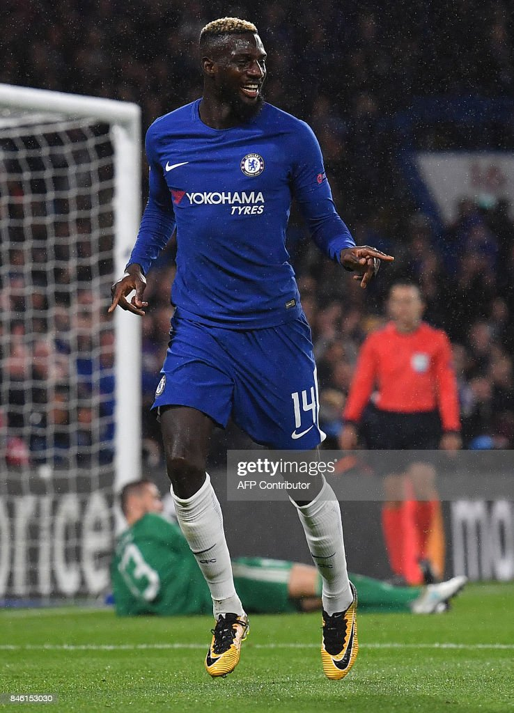 Chelsea's French midfielder Tiemoue Bakayoko celebrates scoring his team's fourth goal with Chelsea's Belgian midfielder Eden Hazard during the UEFA Champions League Group C football match between Chelsea and Qarabag at Stamford Bridge in London on September 12, 2017. / AFP PHOTO / Ben STANSALL