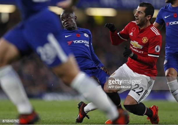 Chelsea's French midfielder Tiemoue Bakayoko fouls Manchester United's Armenian midfielder Henrikh Mkhitaryan during the English Premier League...