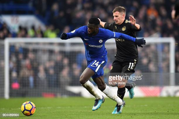 Chelsea's French midfielder Tiemoue Bakayoko holds off Leicester City's English midfielder Marc Albrighton during the English Premier League football...