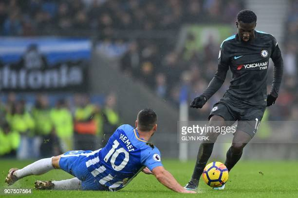 Chelsea's French midfielder Tiemoue Bakayoko is tackled by Brighton's Israeli striker Tomer Hemed during the English Premier League football match...