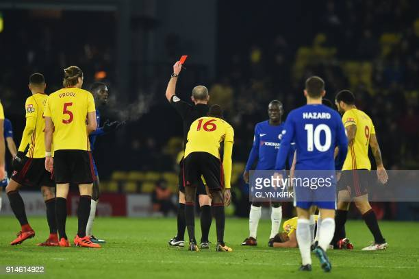Chelsea's French midfielder Tiemoue Bakayoko receives a red card during the English Premier League football match between Watford and Chelsea at...