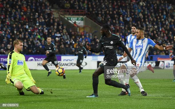 Chelsea's French midfielder Tiemoue Bakayoko shoots and scores past Huddersfield Town's Danish goalkeeper Jonas Lossi during the English Premier...