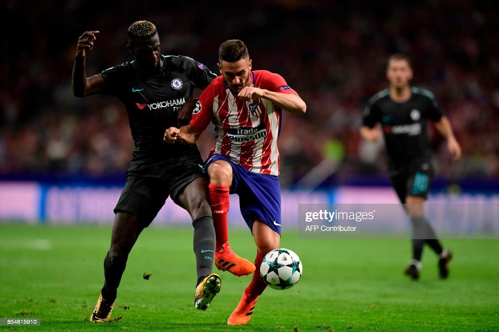 Chelsea's French midfielder Tiemoue Bakayoko (L) vies with Atletico Madrid's midfielder Koke during the UEFA Champions League Group C football match Club Atletico de Madrid vs Chelsea FC at the Metropolitan stadium in Madrid on September 27, 2017. /