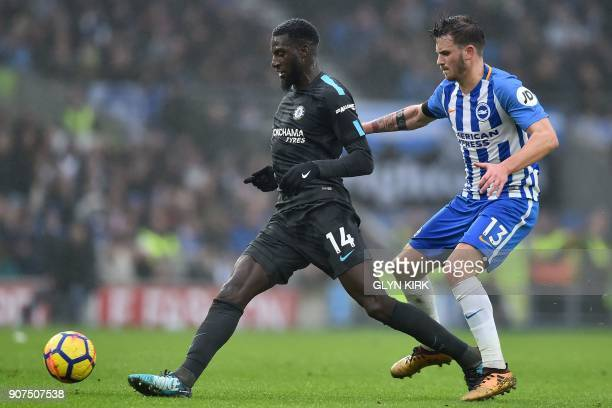 Chelsea's French midfielder Tiemoue Bakayoko vies with Brighton's German goalkeeper Pascal Gross during the English Premier League football match...