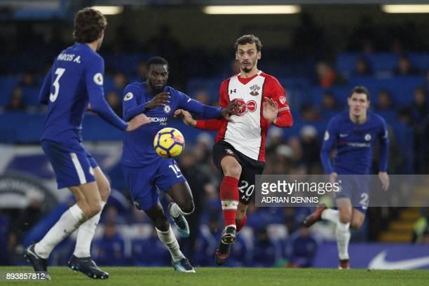 Chelsea's French midfielder Tiemoue Bakayoko vies with Southampton's Italian striker Manolo Gabbiadini during the English Premier League football...