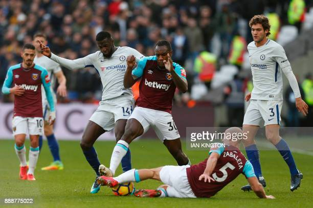 Chelsea's French midfielder Tiemoue Bakayoko vies with West Ham United's English midfielder Michail Antonio and West Ham United's Argentinian...
