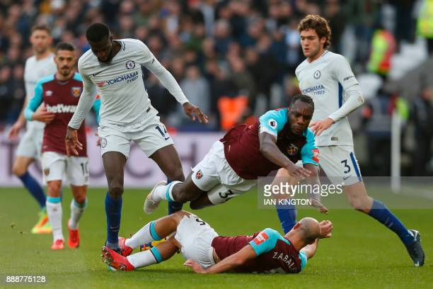 Chelsea's French midfielder Tiemoue Bakayoko watches as West Ham United's English midfielder Michail Antonio falls over West Ham United's Argentinian...