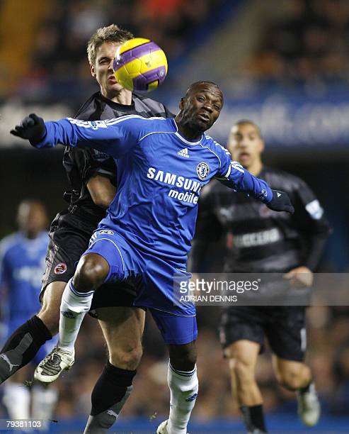 Chelsea's French p Claude Makelele competes for the ball against Reading's Kevin Doyle during the Premiership football match at Stamford Bridge in...