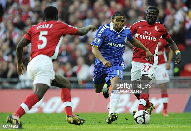 Chelsea's French player Florent Malouda runs for the ball against Arsenal's Kolo Toure and Emmanuel Eboue during the FA Cup SemiFinal football match...