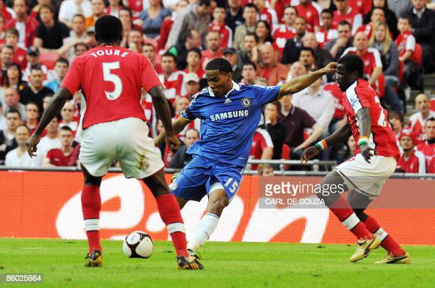 Chelsea's French player Florent Malouda scores the second goal of the match past Arsenal's Ivorian defender Kolo Toure and Arsenal's Ivorian...