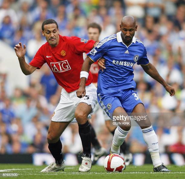Chelsea's French Striker Nicolas Anelka vies with Manchester United's English Defender Rio Ferdinand during their Premier League at Stamford Bridge...