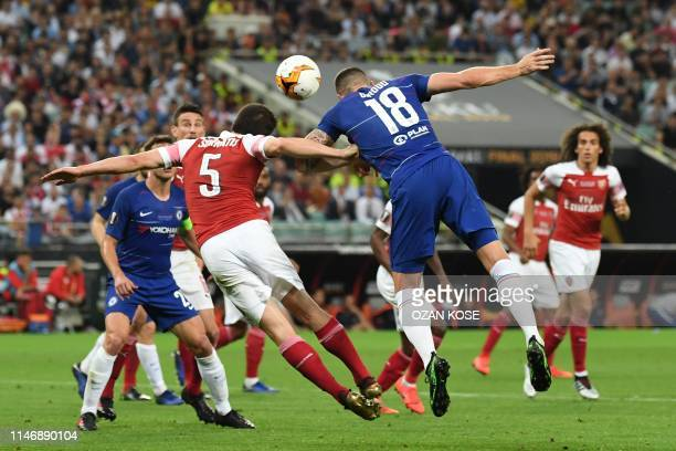Chelsea's French striker Olivier Giroud and Arsenal's Greek defender Sokratis Papastathopoulos jump for the ball during the UEFA Europa League final...