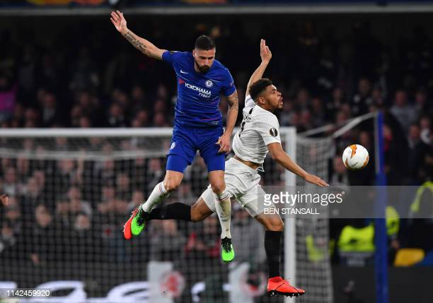 Chelsea's French striker Olivier Giroud and Eintr Frankfurt's French defender Simon Falette collide during the UEFA Europa League semifinal second...