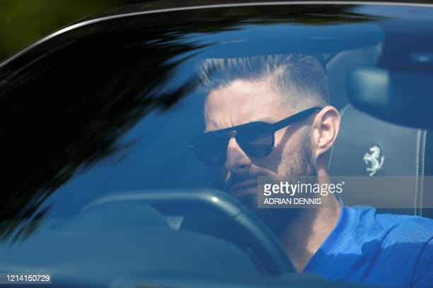 Chelsea's French striker Olivier Giroud arrives at Chelsea's Cobham training facility in Stoke D'Abernon southwest of London on May 20 2020 as...