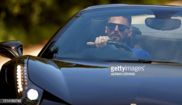 Chelsea's French striker Olivier Giroud arrives at Chelsea's Cobham training facility in Stoke D'Abernon, south-west of London on May 20, 2020 as...