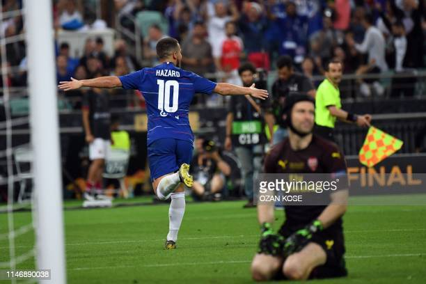 TOPSHOT Chelsea's French striker Olivier Giroud celebrates after scoring a goal as Arsenal's Czech goalkeeper Petr Cech reacts during the UEFA Europa...