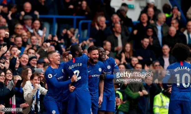 Chelsea's French striker Olivier Giroud celebrates after scoring his team's fourth goal during the English Premier League football match between...