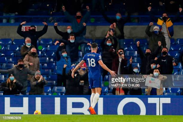 Chelsea's French striker Olivier Giroud celebrates after scoring the equalising goal in front of the Chelsea fans during the English Premier League...