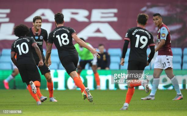 Chelsea's French striker Olivier Giroud celebrates scoring his team's second goal during the English Premier League football match between Aston...
