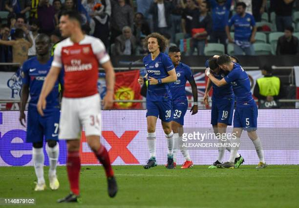Chelsea's French striker Olivier Giroud celebrates scoring the opening goal with his teammates during the UEFA Europa League final football match...