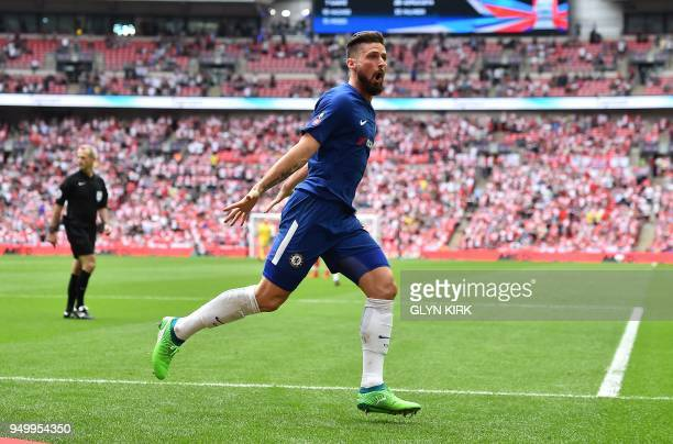 TOPSHOT Chelsea's French striker Olivier Giroud celebrates scoring the opening goal during the English FA Cup semifinal football match between...