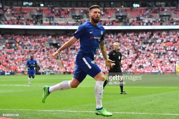 Chelsea's French striker Olivier Giroud celebrates scoring the opening goal during the English FA Cup semifinal football match between Chelsea and...