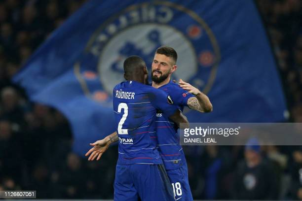 Chelsea's French striker Olivier Giroud celebrates with Chelsea's German defender Antonio Rudiger after scoring the opening goal of the UEFA Europa...