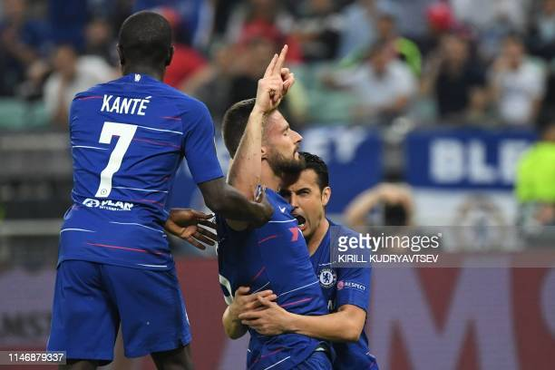 Chelsea's French striker Olivier Giroud celebrates with teammates after scoring a goal during UEFA Europa League final football match between Chelsea...