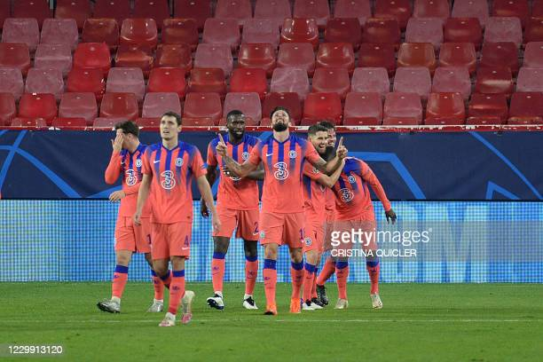 Chelsea's French striker Olivier Giroud celebrates with teammates after scoring his third goal during the UEFA Champions League group E football...