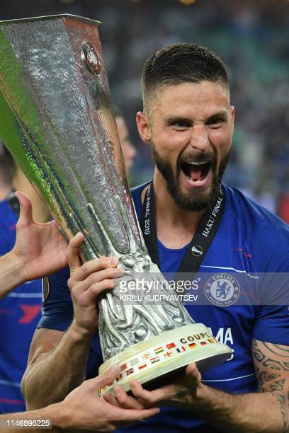 TOPSHOT Chelsea's French striker Olivier Giroud celebrates with the trophy after winning the UEFA Europa League final football match between Chelsea...