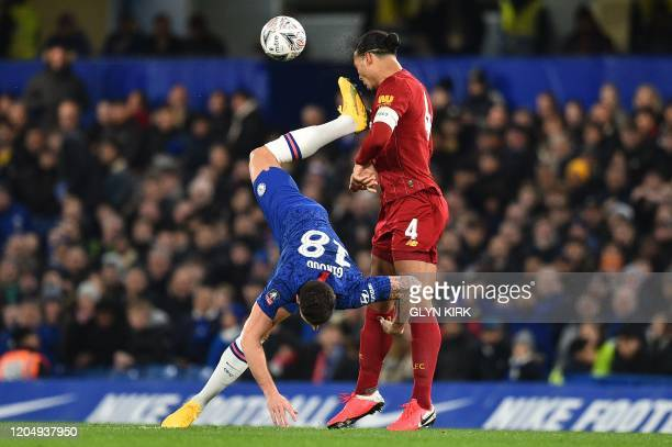 Chelsea's French striker Olivier Giroud clashes with Liverpool's Dutch defender Virgil van Dijk during the English FA Cup fifth round football match...