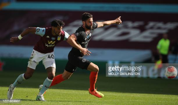 Chelsea's French striker Olivier Giroud fights for the ball with Aston Villa's English defender Tyrone Mings during the English Premier League...