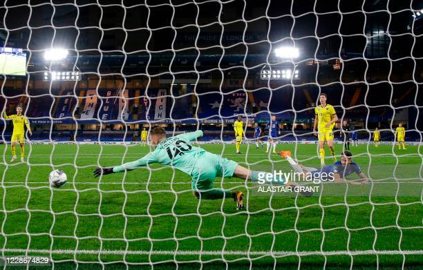 Chelsea's French striker Olivier Giroud heads the ball and scores his team's sixth goal during the English League Cup third round football match...