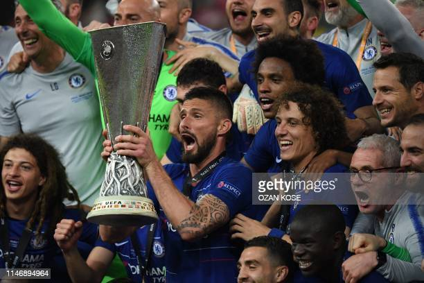 Chelsea's French striker Olivier Giroud holds the trophy as he celebrates with teammates after winning the UEFA Europa League final football match...