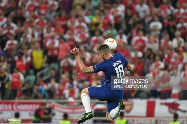 Chelsea's French striker Olivier Giroud jumps for the ball during the UEFA Europa League final football match between Chelsea FC and Arsenal FC at...