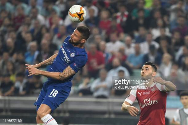Chelsea's French striker Olivier Giroud jumps for the ball next to Arsenal's Germanborn Bosnian defender Sead Kolasinac during the UEFA Europa League...