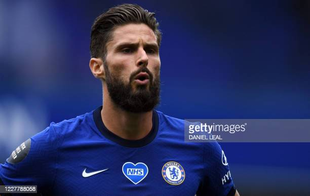 Chelsea's French striker Olivier Giroud reacts during the English Premier League football match between Chelsea and Wolverhampton Wanderers at...