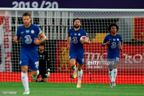 Chelsea's French striker Olivier Giroud runs back with the ball after scoring their first goal during the English Premier League football match...