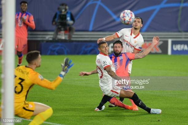 Chelsea's French striker Olivier Giroud scores a goal past Sevilla's Spanish goalkeeper Alfonso Pastor during the UEFA Champions League group E...