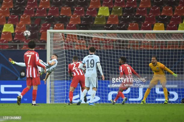 Chelsea's French striker Olivier Giroud scores during the UEFA Champions League round of 16 first leg football match between Club Atletico de Madrid...