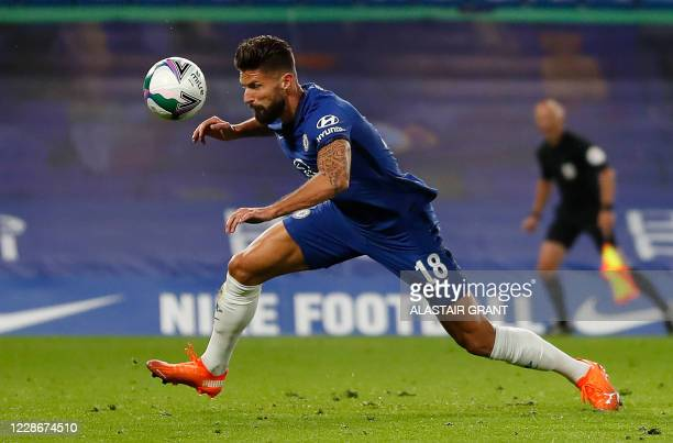 Chelsea's French striker Olivier Giroud scors his team's sixth goal during the English League Cup third round football match between Chelsea and...